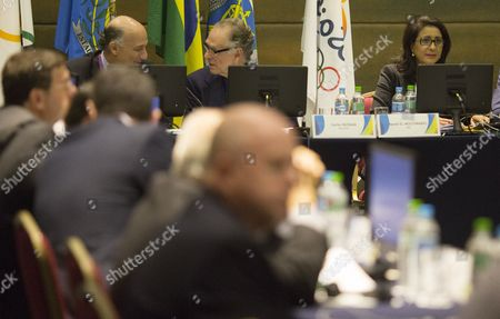 Nawal El Moutawakel, Carlos Arthur Nuzman, Sidney Levy Nawal El Moutawakel, head of the International Olympic Committee's evaluation commission, right, Brazil Olympic Committee President Carlos Arthur Nuzman, top center, and Rio 2016 Committee Chief Executive Officer Sidney Levy attend a meeting in Rio de Janeiro, Brazil, . The IOC's coordination commission is visiting Rio as the city races to be ready on time for South America's first games