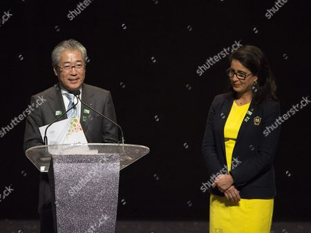 Tsunekazu Takeda, Nawal El Moutawakel Japan's Olympic representative Tsunekazu Takeda, left, speaks as he holds the official invitation for the 2016 Olympic games as Nawal El Moutawakel, head of the International Olympic Committee's evaluation commission looks at, during the ceremony celebrating exactly one year ahead of the start of Rio de Janeiro's Olympics, at Barra, in Rio de Janeiro, Brazil, . A recently released Associated Press study showed dangerously high levels of disease-causing viruses in all water-related venues, and the World Health Organization has asked the IOC to pursue viral testing in Rio during the next year