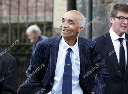 Kenny Lynch leaves the church after the service during the funeral of singer Cilla Black at St Mary's Church in Liverpool, England