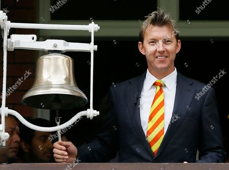 Former Australian cricket team player Brett Lee rings the bell to signify five minutes to the start of play on the second day of the second Ashes Test match between England and Australia, at Lord's cricket ground in London