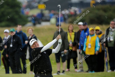 United States' Mark Calcavecchia plays a shot on hole 17 during the first round of the British Open Golf Championship at the Old Course, St. Andrews, Scotland