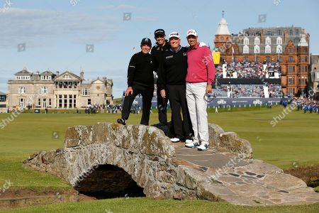 From left, South Africa's Gary Player, Ireland's Padraig Harrington, United States' Mark Calcavecchia, and United States' Stewart Cink pose for a photograph on Swilcan Bridge during a special Champion Golfers' challenge at the British Open Golf Championship at the Old Course, St. Andrews, Scotland