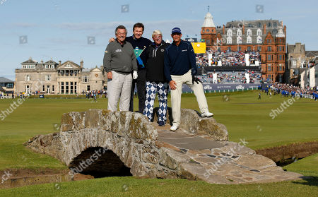 From left, England's Tony Jacklin, England's Nick Faldo, United States' John Daly, and United States' Tom Lehman pose for a photograph on Swilcan Bridge during a special Champion Golfers' challenge at the British Open Golf Championship at the Old Course, St. Andrews, Scotland