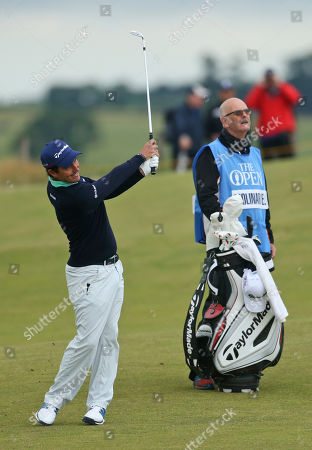 Italy's Edoardo Molinari plays his second shot on the seventh hole during a practice round at the British Open Golf Championship at the Old Course, St. Andrews, Scotland