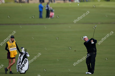 United States' Mark Calcavecchia plays a shot on the first hole during a special Champion Golfers' challenge at the British Open Golf Championship at the Old Course, St. Andrews, Scotland