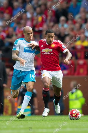 Manchester United's Memphis Depay, right, fights for the ball against Newcastle's Gabriel Obertan during the English Premier League soccer match between Manchester United and Newcastle at Old Trafford Stadium, Manchester, England