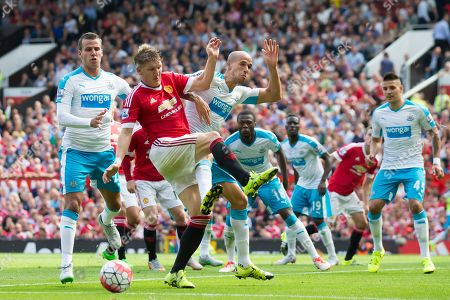 Manchester United's Bastian Schweinsteiger, second left, fights for the ball against Newcastle's Gabriel Obertan, centre left, during the English Premier League soccer match between Manchester United and Newcastle at Old Trafford Stadium, Manchester, England