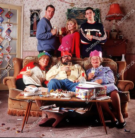 'The Royle Family' Christmas - 2000 Back L-R: Dave Best [Craig Cash]. Denise Best [Caroline Aherne] and Anthony Royle [Ralf Little]. Front L-R: Barbara Royle [Sue Johnston], Jim Royle [Ricky Tomlinson] and Norma Speakman [Liz Smith]