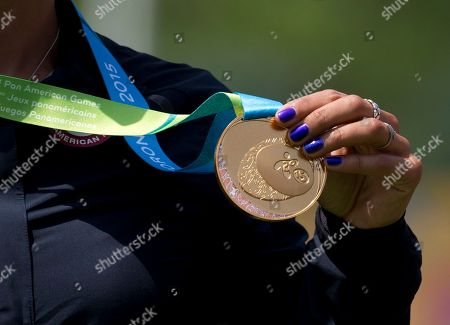 Khatuna Lorig of the U.S. holds up her gold medal for women's individual archery, during the medals ceremony, at the Pan Am Games in Toronto