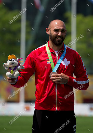 Stock Picture of Jay Lyon Canada's Jay Lyon stands on the podium after receiving his bronze medal in men's individual archery, at the Pan Am Games in Toronto