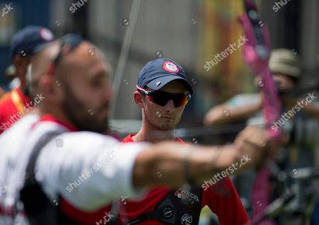 Zach Garrett Zach Garrett of the U.S. watches as opponent Jay Lyon of Canada shoots in the bronze medal event of the men's individual archery, at the Pan Am Games in Toronto, . Lyon took the bronze