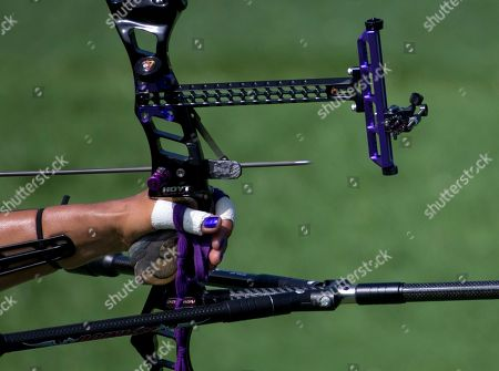 An arrow leaves the bow of Khatuna Lorig of the U.S. as she shoots during a semifinal of the women's individual archery, at the Pan Am Games in Toronto, . She went on to win gold in the event