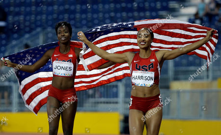 Queen Harrison, Tenaya Jones USA's Queen Harrison, right, and Tenaya Jones hold up their country's flag after winning the women's 100 meter hurdles at the Pan Am Games in Toronto, . Harrison won the gold medal and Jones the silver