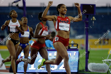 Queen Harrison USA's Queen Harrison celebrates after she crosses the finish line to win the women's 100 meter hurdles at the Pan Am Games in Toronto