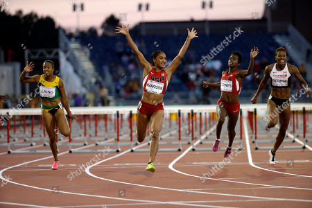 Queen Harrison USA's Queen Harrison celebrates as she crosses the finish line to win the women's 100 meter hurdles at the Pan Am Games in Toronto