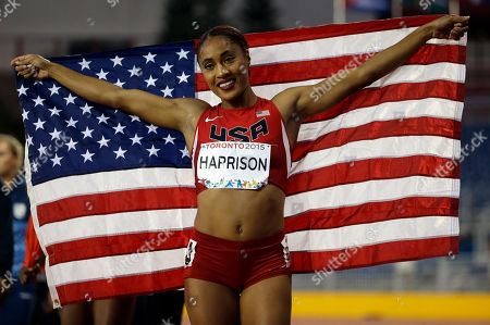 Queen Harrison USA's Queen Harrison holds up her country's flag after winning the women's 100 meter hurdles at the Pan Am Games in Toronto