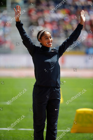 Queen Harrison Gold medalist Queen Harrison celebrates during the medal ceremony for the women's 110 meter hurdles at the Pan Am Games, in Toronto