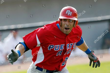 Aldo Mendez Puerto Rico's Aldo Mendez reacts toward his team's dugout after hitting a home run off United States pitcher Scott McGregor during the sixth inning of a baseball game at the Pan Am Games, in Ajax, Ontario