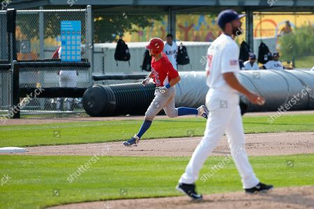 Stock Image of Richard Thon, Scott McGregor Puerto Rico's Richard Thon, left, runs the bases as United States pitcher Scott McGregor walks back to the mound after Thon hit a home run off him during the sixth inning of a baseball game at the Pan Am Games, in Ajax, Ontario
