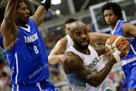 Brazil's Larry Taylor, right, drives against Dominican Republic's Edward Santana during a men's basketball semifinal game at the Pan Am Games in Toronto, Ontario
