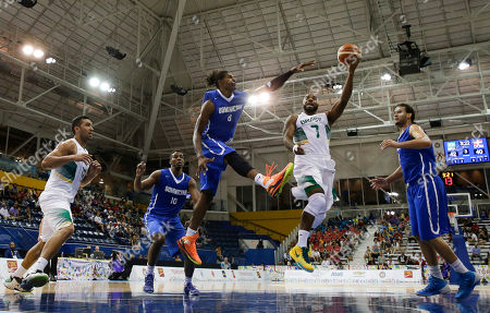 Stock Image of Brazil's Larry Taylor, center right, goes up for a shot against Dominican Republic's Edward Santana during a men's basketball semifinal game at the Pan Am Games in Toronto, Ontario