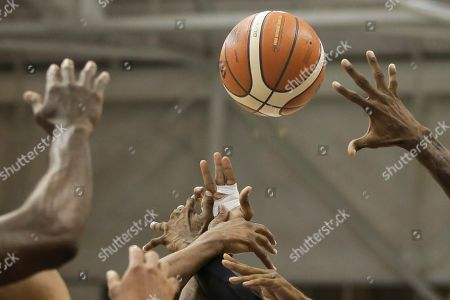 Stock Picture of Brazil's Larry Taylor, center, battles with Dominican Republic's Edward Santana, right, Angel Suero, center left, and James Stokley during a men's basketball semifinal game at the Pan Am Games in Toronto, Ontario
