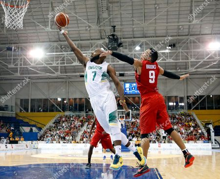 Larry Taylor, Dillon Brooks Brazil's Larry Taylor, left, goes up for a shot against Canada's Dillon Brooks during the third quarter of the men's basketball gold medal game at the Pan Am Games, in Toronto