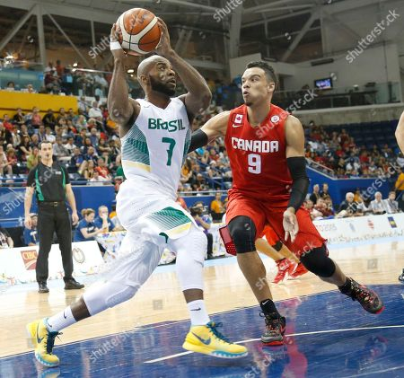Larry Taylor, Dillon Brooks Brazil's Larry Taylor, left, drives to the basket against Canada's Dillon Brooks during the third quarter of the men's basketball gold medal game at the Pan Am Games, in Toronto