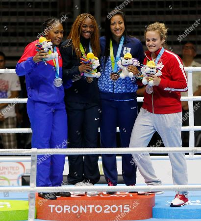 Claressa Shields, Yenebier Guillen Benitez United States gold medalist Claressa Shields, second from left, stands with Dominican Republic silver medalist Yenebier Guillen Benitez, left, Argentine silver medalist Lucia Perez and Canadian bronze medalist Arian Fortin during the women's middleweight medal ceremony at the Pan Am Games, in Oshawa, Ontario