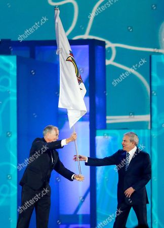 Ivar Sisniega, Luis Castaneda Lossio Ivar Sisniega, left, the vice president of the Pan American Sports Organization, hands the PASO flag over to Luis Castaneda Lossio, the mayor of Lima, Peru, during the closing ceremony of the Pan Am Games, in Toronto. Lima will be the host city for the 2019 Pan Am Games