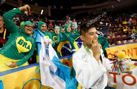 Charles Chibana Brazil's Charles Chibana, center, poses for photographers with his men's -66kg gold medal near supporters after winning his judo match over Canada's Antoine Bouchard at the Pan Am Games, in Mississauga, Ontario