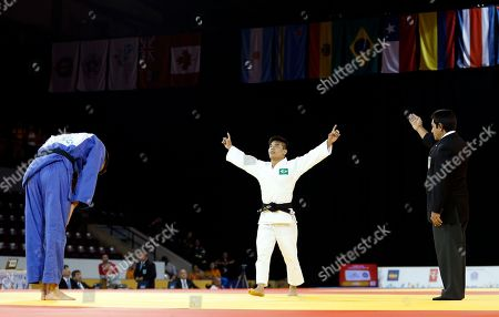 Charles Chibana, Antoine Bouchard Brazil's Charles Chibana, center, celebrates after beating Canada's Antoine Bouchard, left, during the men's -66kg gold medal match at the Pan Am Games, in Mississauga, Ontario