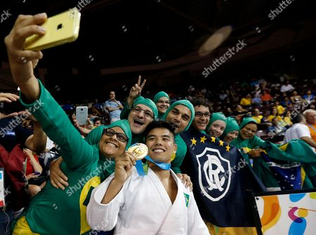 Stock Picture of Charles Chibana Brazil's Charles Chibana, center, poses with supporters after winning the men's -66kg gold medal judo match over Canada's Antoine Bouchard at the Pan Am Games, in Mississauga, Ontario