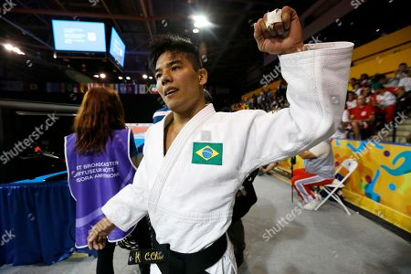 Charles Chibana Brazil's Charles Chibana acknowledges the crowd after winning the men's -66kg gold medal judo match over Canada's Antoine Bouchard at the Pan Am Games, in Mississauga, Ontario