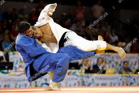 Stock Photo of Charles Chibana, Antoine Bouchard Brazil's Charles Chibana competes against Canada's Antoine Bouchard during the men's -66kg gold medal judo match at the Pan Am Games, in Mississauga, Ontario