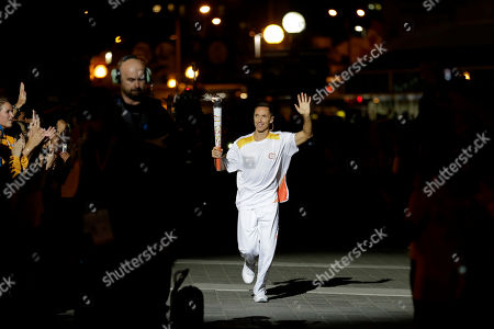 Steve Nash Former Canadian basketball player Steve Nash runs with the torch before lighting the cauldron during the opening ceremony for the Pan Am Games in Toronto