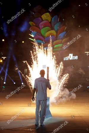 Steve Nash Former Canadian basketball player Steve Nash lights the cauldron during the opening ceremony for the Pan Am Games in Toronto