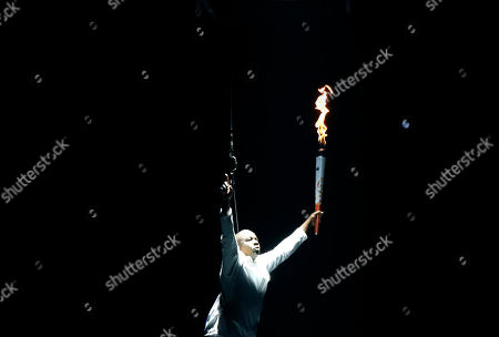 Donovan Bailey Retired Canadian sprinter Donovan Bailey is lowered to the stage with the Pan Am torch during the opening ceremony of the 2015 Pan Am Games in Toronto