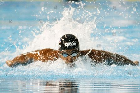 Giles Smith United States' Giles Smith swims for the gold medal in the the men's 100m butterfly final at the Pan Am Games, in Toronto