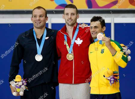 Ryan Cochrane, Ryan Feeley, Leonardo De Deus Gold medalist Ryan Cochrane, center, of Canada, poses for photographers with silver medalist Ryan Feeley, of the United States, and bronze medalist Leonardo De Deus, of Brazil, during the men's 400m freestyle medal ceremony at the Pan Am Games, in Toronto