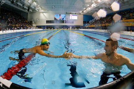 Ryan Cochrane, Leonardo De Deus Canada's Ryan Cochrane, right, celebrates his gold medal performance with bronze medalist Brazil's Leonardo De Deus in the men's 400m freestyle final at the Pan Am Games, in Toronto
