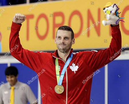 Ryan Cochrane Ryan Cochrane, of Canada poses with his gold medal for the men's 1500 meter freestyle swimming event at the Pan Am Games, in Toronto
