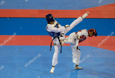 Celina Proffen, Vanessa Vasquez Argentina's Celina Proffen, left, fights El Salvador's Vanessa Vasquez in a repechage match to determine who will fight in a bronze medal match in the women's taekwondo under-57kg category, at the Pan Am Games in Mississauga, Ontario