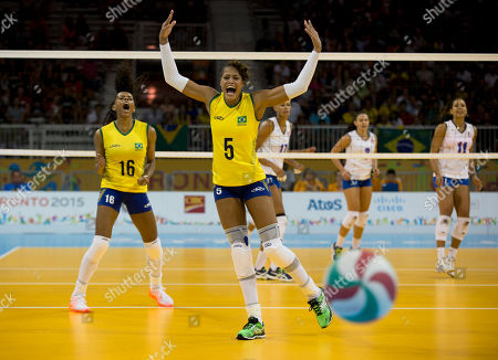 Adenizia Da Silva, Fernanda Rodrigues Brazil's Adenizia Da Silva, center, and Fernanda Rodrigues, left, react as a strike from Puerto Rico goes out of bounds, in one of the final points of set 5 of their preliminary match at the Pan Am Games in Toronto