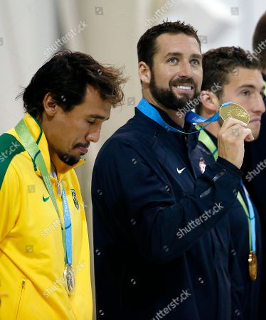 Merrill Moses, Thye Mattos Ventura Bezerra United States goalkeeper Merrill Moses, right, shows off his gold medal as Brazil goalkeeper Thye Mattos Ventura Bezerra hangs his head with his silver medal during the medal ceremony in the men's water polo tournament at the Pan Am Games, in Markham, Ontario. The U.S. beat Brazil 11-9