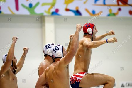 United States players celebrate a save by goalkeeper Merrill Moses during the second half of the men's water polo gold medal match against Brazil at the Pan Am Games, in Markham, Ontario. The U.S. won 11-9