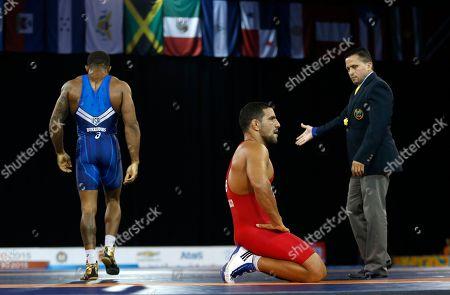 Yoan Blanco, Jordan Burroughs Ecuador's Yoan Blanco, center, reacts after losing to United States' Jordan Burroughs during the men's freestyle 74 kg gold medal wrestling match at the Pan Am Games, in Mississauga, Ontario