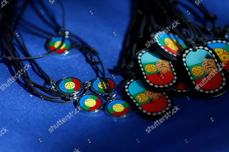 Necklaces with the Mapuche flag design are displayed for sale in Santiago, Chile. Popular singer Ana Tijoux has waved the multicolored Mapuche flag during her concerts and raps about their struggle in her Grammy-nominated albums
