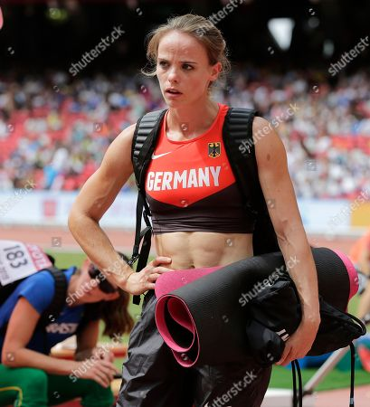 Germany's Silke Spiegelburg leaves the arena after women's pole vault qualification at the World Athletics Championships at the Bird's Nest stadium in Beijing