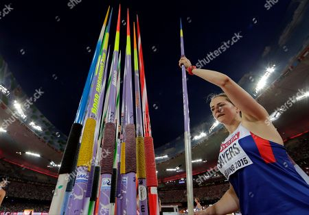 Britain's Goldie Sayers takes a javelin from the rack as she competes in women's javelin throw qualification at the World Athletics Championships at the Bird's Nest stadium in Beijing